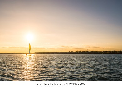 People sailing at sunset in tropical scenery. Laguna de Siete Colores, Bacalar, Quintana Roo, Mexico. December 2019.