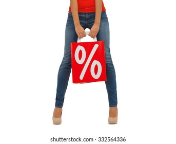 people, sale and discount concept - close up of woman with percentage sign on red shopping bag