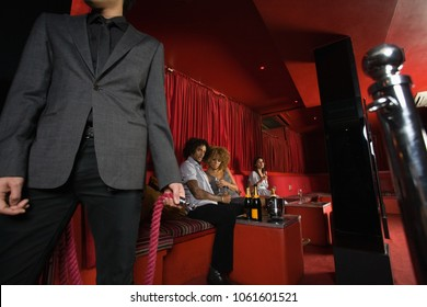 People sat in a vip area of a nightclub