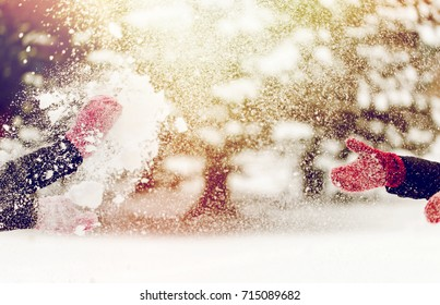 people, season, winter holidays and christmas concept - happy friends playing with snow outdoors