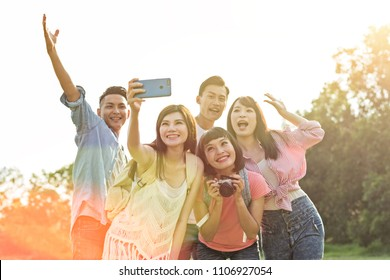 people selfie with his friends in the park
