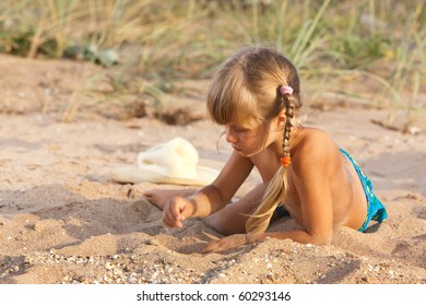 people series: little girl on sea beach are play the sandy game