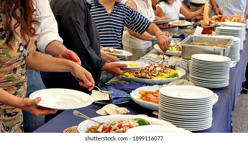 People serving themselves at a buffet, food concept