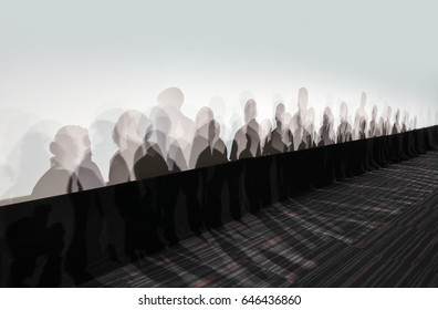 Lot of people shadows on white wall in perspective