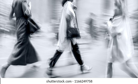 people shopping in the city in motion blur in monochrome blue tonality