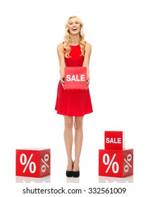 people, shopping, discount and holidays concept - smiling woman in red dress holding cardboard box with sale sign