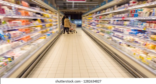 people shopping for food in supermarket interior