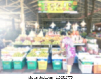 people shopping at fresh market abstract blurred background