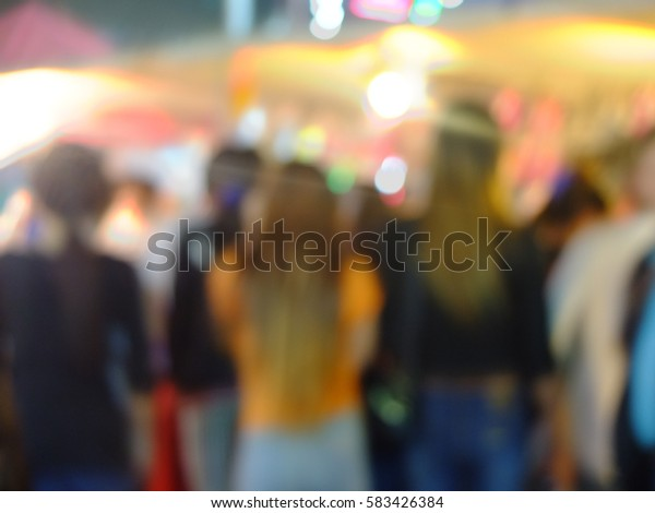 People are shopping at the market on holiday as blurred motion background