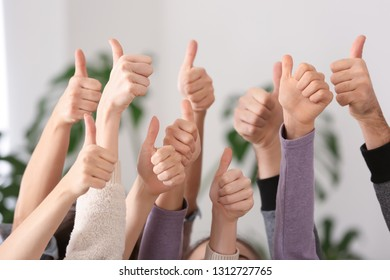 People showing thumb-up gestures as symbol of support