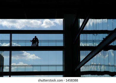 people silhouette in the building