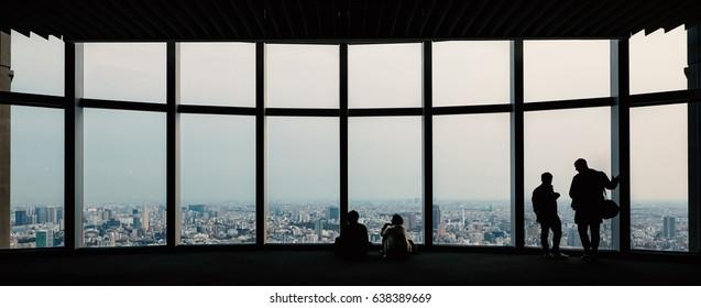 People silhouette inside Observation Deck. Tokyo, Japan.