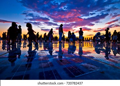 People silhouette on colorful sunset in Zadar, Dalmatia, Croatia