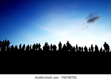 people silhouette on hill