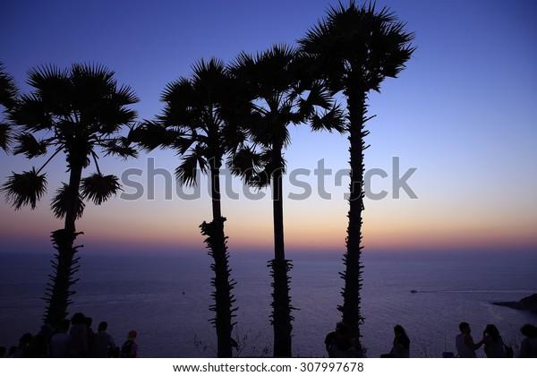 People silhouette stand sunset , Puket Thailand Laem Phrom Thep Cape .
