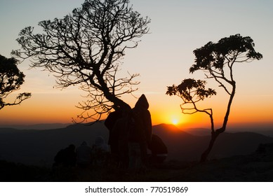 People silhouette at sunrise in Brazil