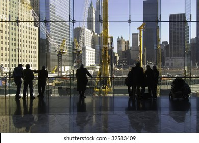 People in silhouette watching Ground Zero reconstruction