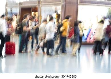 People silhouettes in motion blur, airport interior