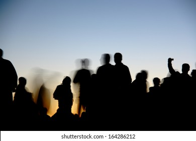people silhouettes  on nemrut mountain waiting sunrise