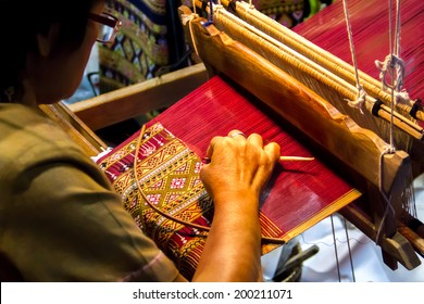 People are silk weaving in Thailand
