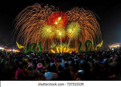 People sit and watch the fireworks show at Phra Nang Naga fireball festival on the Mekong River around October, Nongkhai, Thailand every year.