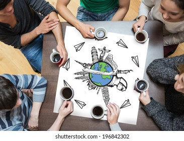 People sitting around table drinking coffee with page showing landmarks of the world with airplane doodle