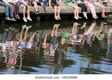 People sitting by the river