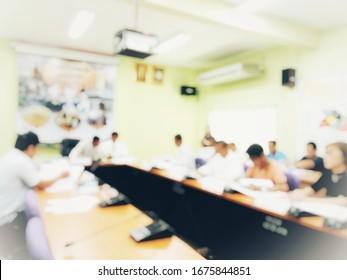 People sitting in meeting room, blurred image