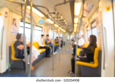 People Sitting on Mass Transit (Sky Train or Subway), Abstract Blur Defocus Background.