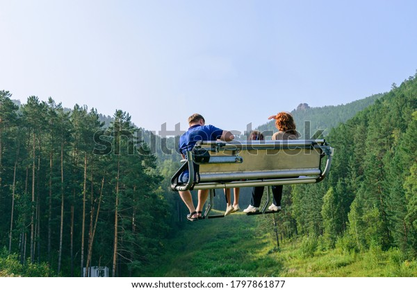 people-sitting-on-metal-bench-600w-17978