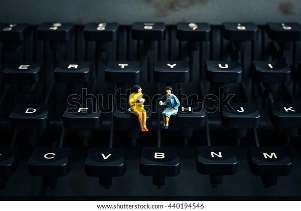 people sitting on the typewriter