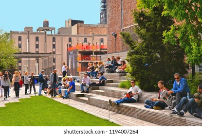 People sitting on wooden benches on highline, high line park, urban in NYC with tourists resting relaxing in Chelsea West Side by Hudson Yards, Manhattan 25.05.2016.