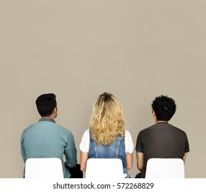 People sitting rear view group