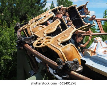 People sitting in roller coaster.  Attraction in Familypark, St. Margarethen, Burgenland, Austria, June 2017.