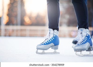 people skating on the ice city rink