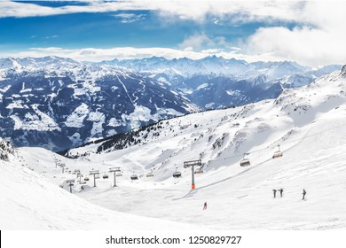People skiing on prepared slopes covered by fresh snow in Austrian Alps, Zillertal, Austria, Europe.