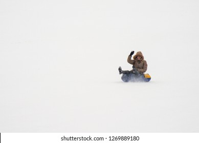 People skiing and sledding in the winter from the mountain, Grodno, Belarus January 13, 2018