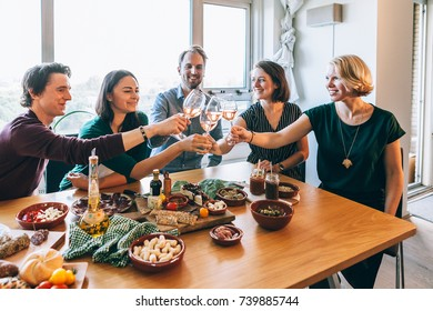 people smiling and having fun sitting around a table