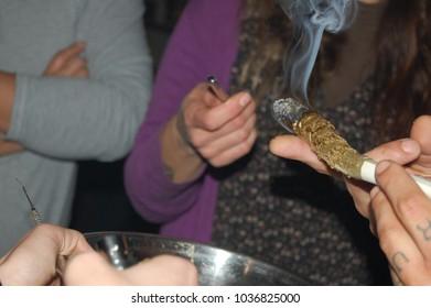 people smoking a huge cannabis blunt
