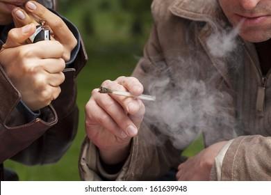 People smoking maijuana from a pipe