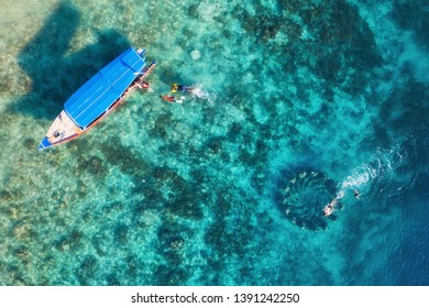 The people are snorkeling near the famous place on Gili Meno Island, Indonesia. Aerial view. Underwater tourism in the ocean. Gili Meno Island, Indonesia. Travel - image