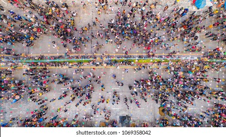 People in Songkran Festival at center of Sukhothai province, Aerial view form flying drone