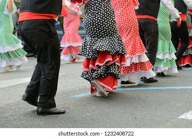 people in Spanish carnival costumes on the street