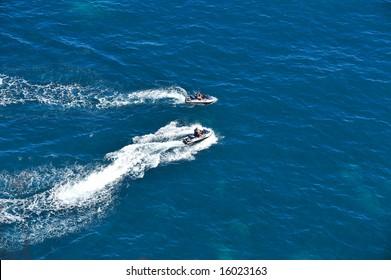 people speeding on ski-jet
