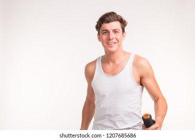 People, sport and fitness concept - sexy muscled man holding dumbbell on white background