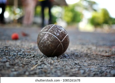 people at sport playing game petanque.OLD vintage Petanque on blur background.