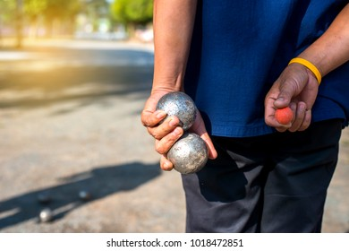 people at sport playing game petanque.Petanque on blur background.