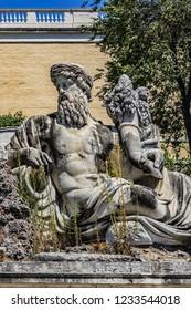 People Square (Piazza del Popolo) in Rome. Fountain of goddess of Rome (Fontana della dea di Roma) with allegorical figures representing rivers Tiber and Aniene on eastern end of People Square Square.