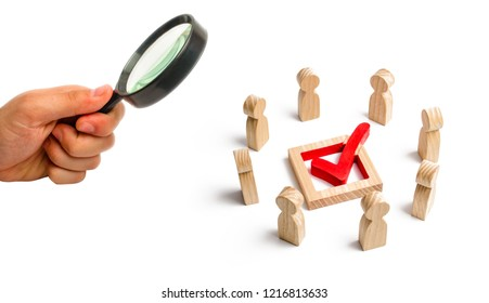 People stand in a circle and look at the check mark in the box. election, poll or referendum. Poll people. Voters participate in elections of parliament. Decision making, teamwork. Selective focus