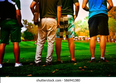 people stand on grass looking golf tournament